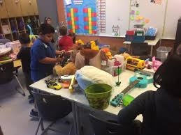 motivated sellers first graders use garage sale to benefit