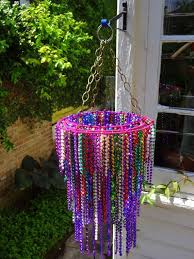 mardi gras bead chandelier mardi gras chandelier use drying peg ring and necklace