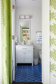 white washstand with blue geometric floor tiles transitional