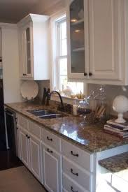 kitchen countertops with white cabinets best countertops for white cabinets 580x385 granite