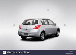 nissan tiida 2008 hatchback 2008 nissan versa sl in silver rear angle view stock photo