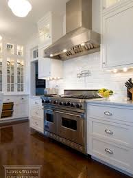 white kitchen cabinets with glass cup pulls lewis weldon custom kitchens home kitchens kitchen design