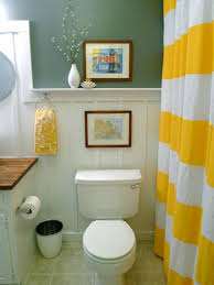 yellow and brown bathroom ideas with massive glass shower wall