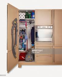 cleaning cupboard in kitchen cabinet set containing vacuum cleaner