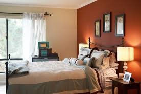 charming bedroom design with orange accents wall painted and