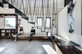 duplex penthouse with creative room dividers and hanging staircase