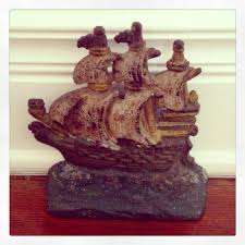 fabulous old cast iron painted ship doorstop great folky charm