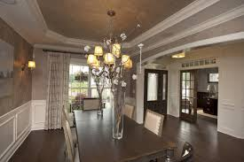 formal dining room with wainscoting and box tray ceiling by 3