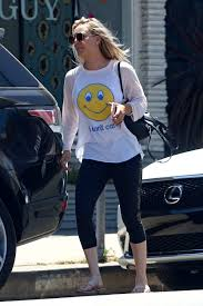 kaley cuoco in a smiley tee and yoga pants leaving a nail salon in
