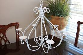 old wrought iron chandeliers with candle holder painted with white