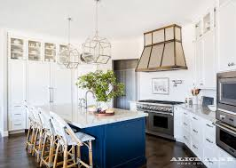 two tone kitchen cabinets and island white kitchen with navy blue island reno ideas home bunch