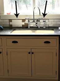 black kitchen cabinets with white subway tile backsplash choosing the right grout color for subway tile help we can