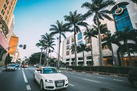 palm audi free stock photo of white audi driving the road with palm