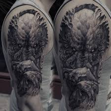 tattoo designs on the arm cthulhu tattoo on the right upper arm and shoulder horror
