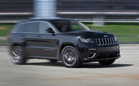 monster jeep grand cherokee 2011 bmw x5 m vs 2012 jeep grand cherokee srt8 vs 2011 porsche