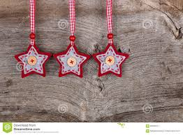 red fabric star merry christmas decoration rustic wood backgroun