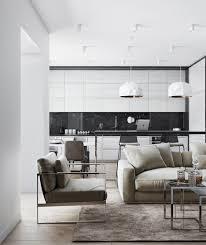 brown sectional rug black marble backsplash white pendant lights