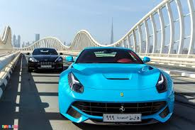 blue ferrari baby blue ferrari f12 berlinetta and rapide in the background