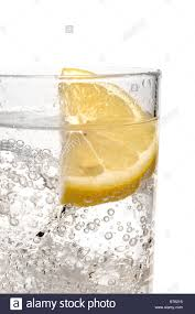 vodka tonic gin vodka and tonic with lemon slice stock photo royalty free