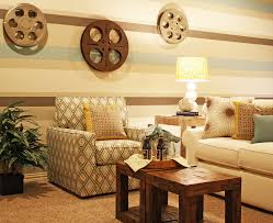 movie theater themed home decor gold nuance movie room decor that has round wooden table beside