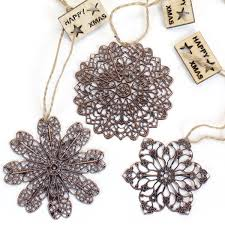 snowflake decorations 3 copper filigree snowflake decorations pipii