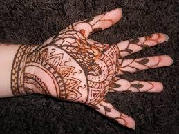 henna tattoos on left palm