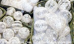 painted white lace tree ornaments decorating