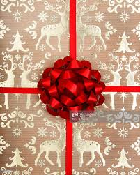 bow wrapping paper christmas wrapping paper and bow stock photo getty images