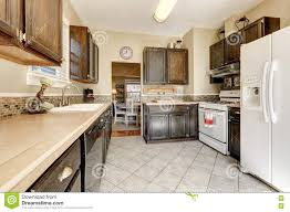 white kitchen cabinets with brown floors kitchen room brown cabinets and white appliances