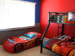 large boys bedroom with red interior theme color and decorative