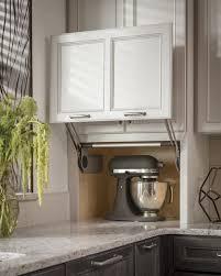 garage door for kitchen cabinet medallion cabinets counter wall with vertical lift door