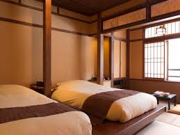 onsen ryokan equipped with beds and western style meals