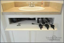 Under The Kitchen Sink Storage Diy Under The Sink Hair Tool Storage Remodelaholic Bloglovin U0027