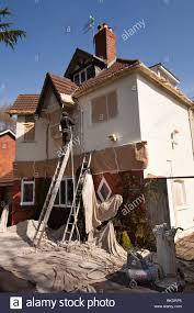 home improvement decorator spraying house walls with andura