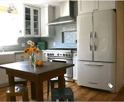 colored kitchen cabinets with stainless steel appliances trendspotting white appliances and how to style them