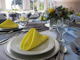 silver wedding plates blue table linen with silver plates yellow napkins farm