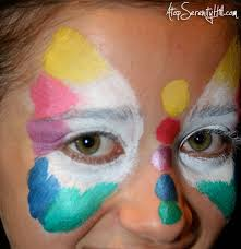 how to do face painting rainbow erfly face paint tutorial atop serenity hill