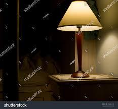 poor lighting light headboard contemporary bedroom stock photo
