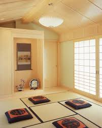 very simple japanese home decor with cushions and shoji screen and