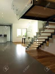 interior of new modern house stairs and kitchen stock photo