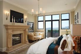 furniture tv over fireplace design in transitional bedroom with