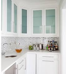 kitchens with glass cabinets love the backsplash it s like confetti in the kitchen design by