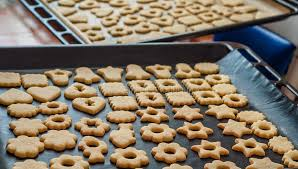traditional czech christmas homemade linzer cookies on baking tin