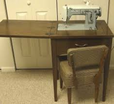 White Sewing Machine Cabinet by Moving Sale List