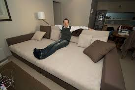 beds and couches how to keep a bed from dominating a mixed use room king size