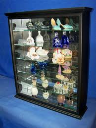 black wall hanging curio cabinet display
