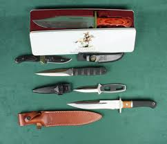 lot of five modern knives in factory cardboard boxes including a