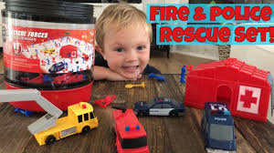 toddler plays with true heroes rescue forces playset bucket from
