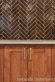 interior contempo brown herringbone tile layout design for