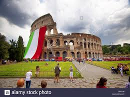 Ancient Roman Empire Flag Italian Flag Hanging On Colosseum Rome Italy Stock Photo